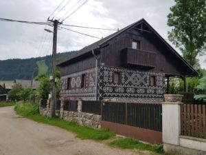 Čičmany is a tourist hot spot due to traditional houses with distinctive folk patterns. A copy of the patterns on a non-historical house.